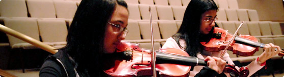 Header Image 15 - violins - 2 girls in a group violin...