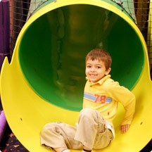Sidebar Image 03 - Boy in Tunnels - a first grade boy playing in...